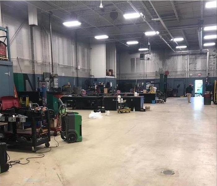 The same warehouse with all the work machines and benches put back in place.