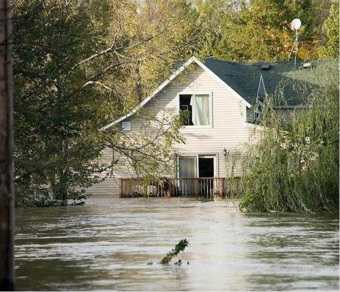 A house is surrounded by floodwaters