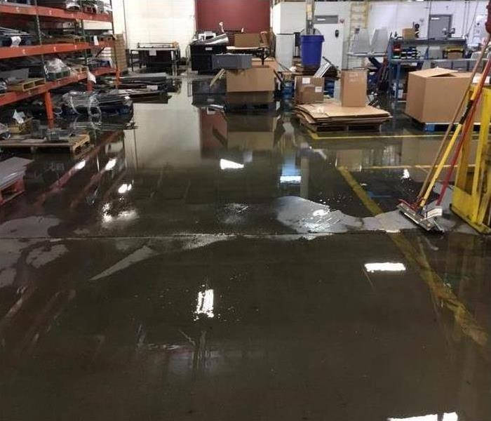 Flood water covers a warehouse floor