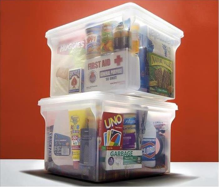Plastic bins filled with nonperishable food and supplies.