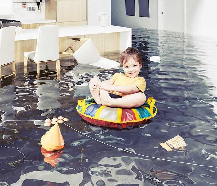 Water Damage Cleanup in East Hartford CT - image of toddler floating through a living room