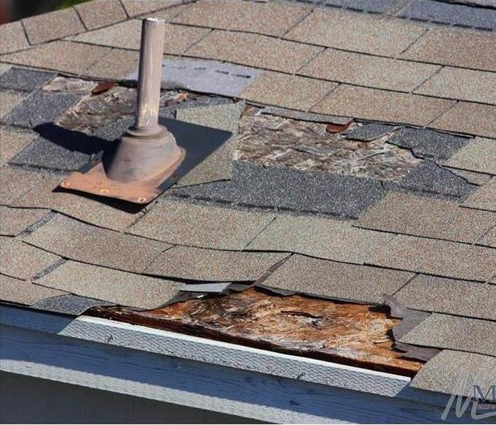 A roof with missing shingles