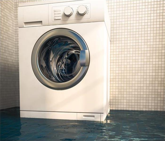A washing machine is surrounded by water